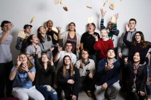 students from FYS bread class toss bread in the air